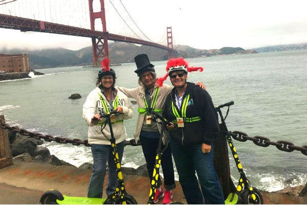 tour-guests-enjoying-electric-scooter-tour-at-fort-point-under-golden-gate-bridge-600-400